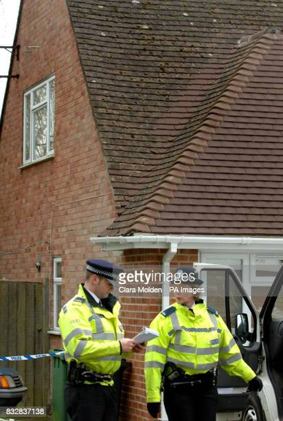 Police officers stand outside a house on Wellington Crecent in Baughurst Hampshire where explosive devices are believed to have been found last night