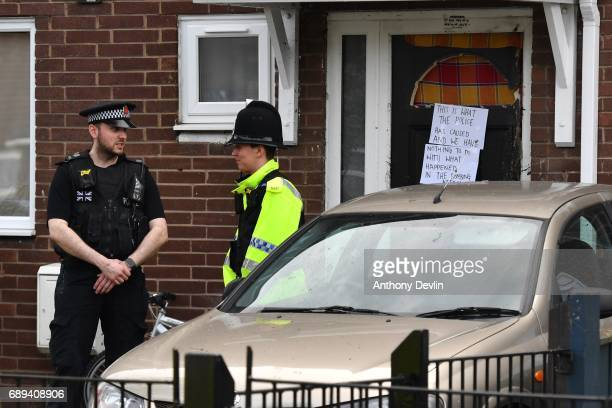 Police officers stand outside a property in Quantock Street in the Moss Side area of Manchester where a raid was carried out earlier on May 28 2017...
