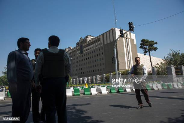 Police officers stand outside Iran's parliament building following an attack by several gunmen on June 7 2017 in Tehran Iran At least 12 people were...