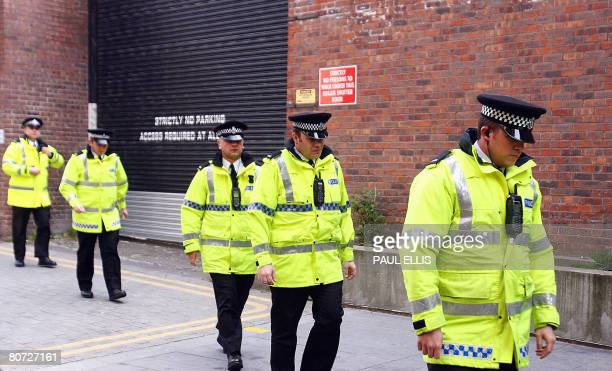 Police officers stand outside Liverpool Magistrates Court in Liverpool north west England on April 17 as a 17 yearold youth is charged with murdering...