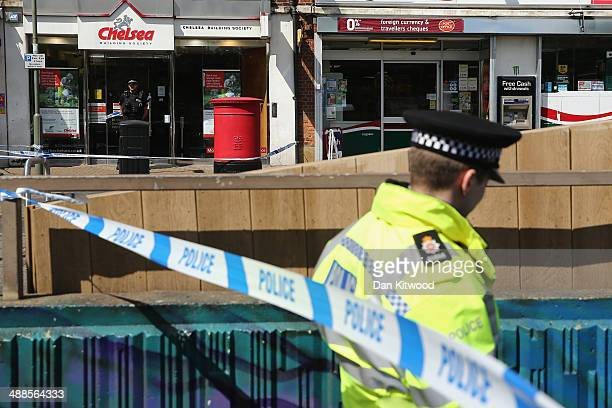 Police Officers stand outside the Chelsea Building Society branch in SunburyonThames on May 7 2014 in Sunbury England The building society was raided...