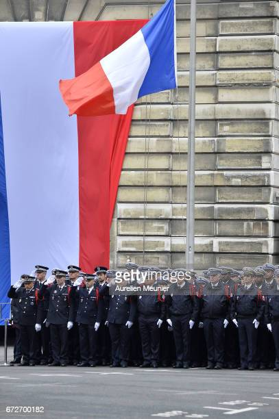 Police officers stand to attention during the National tribute to fallen French Policeman Xavier Jugele on April 25 2017 in Paris France French...