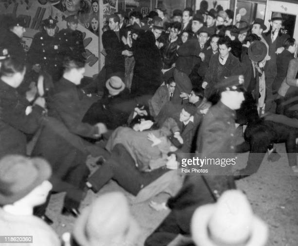 Police officers struggle with crowds gathered to protest against the GermanAmerican Federation meeting chaired by GermanAmerican Bund leader Fritz...