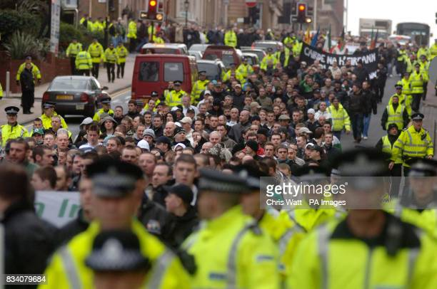 Police officers surround a parade to remember the victims of Bloody Sunday in Glasgow this morning Around 750 people were expected in the city centre...