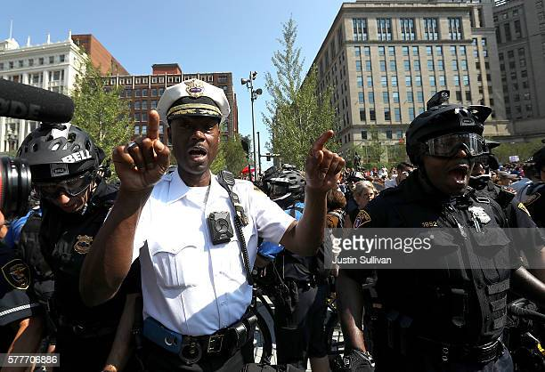 Police officers surround protesters during a demonstration in Cleveland Public Square near the site of the Republican National Convention on July 19...