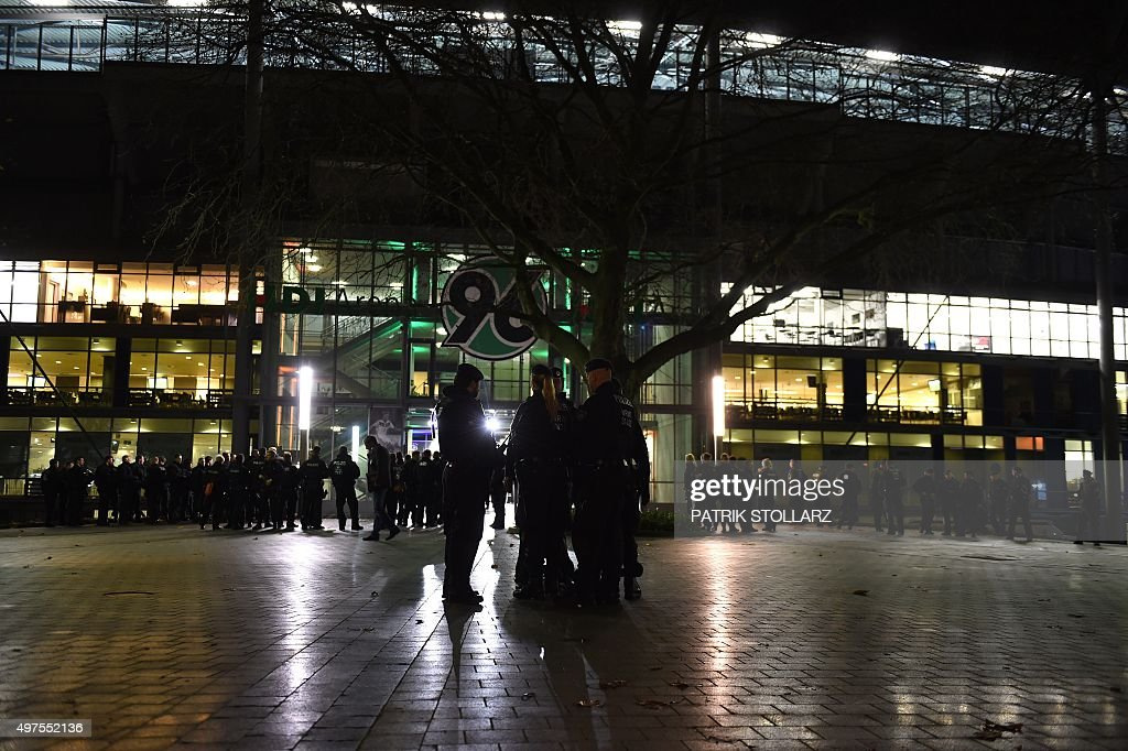 http://media.gettyimages.com/photos/police-officers-survey-outside-the-hdi-arena-after-the-friendly-vs-picture-id497552136