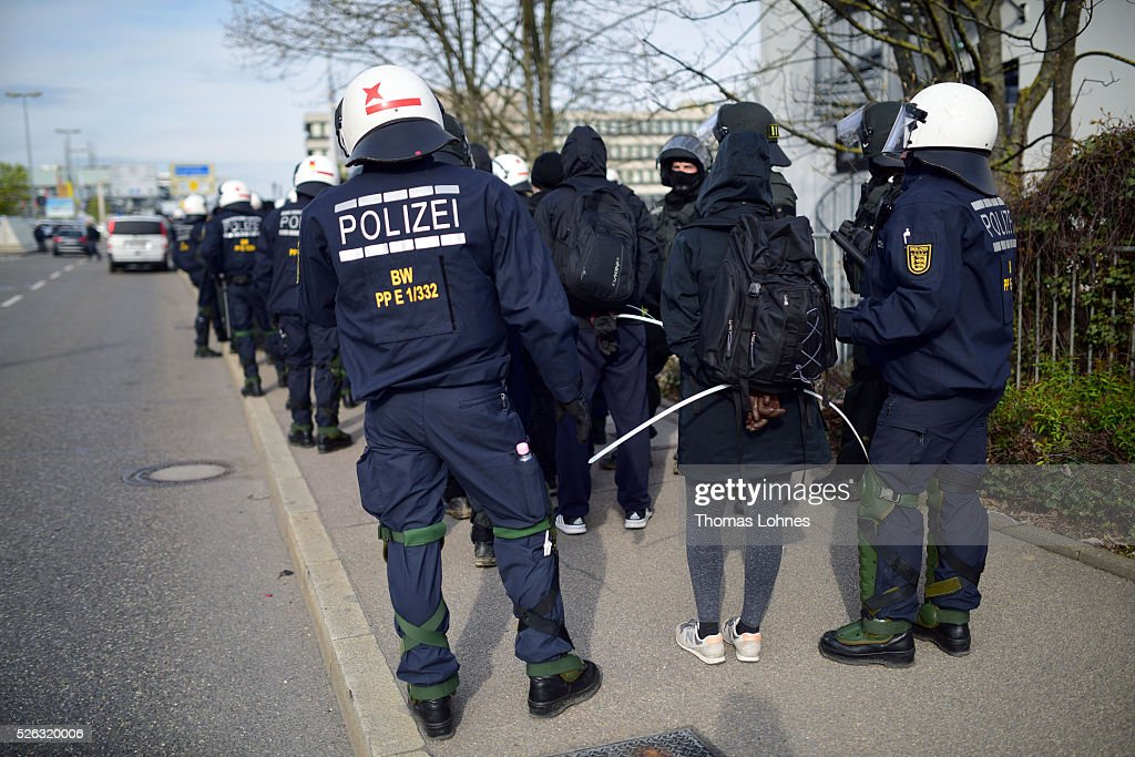 Police officers take anti-AfD-protesters into custody near the AfD (Alternative fuer Deutschland) party's federal congress at the Stuttgart Congress Centre ICS on April 30, 2016 in Stuttgart, Germany. The AfD, a relative newcomer to the German political landscape, has emerged from Euro-sceptic conservatism towards a more right-wing leaning appeal based in large part on opposition to Germany's generous refugees and migrants policy. Since winning seats in March elections in three German state parliaments the party has sharpened its tone, calling for a ban on minarets and claiming that Islam does not belong in Germany.