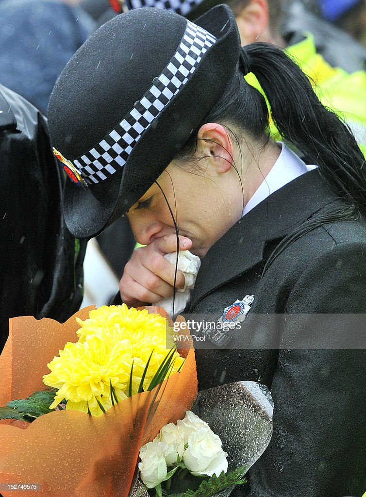 Police officers take part in a memorial vigil at the scene where PC Nicola Hughes and PC Fiona Bone were murdered one week ago, in Mottram on September 25, 2012 in Manchester, England. Members of the public joined police officers in a walk from Hyde police station to the scene of the killings, for a vigil of prayers and reflection. Dale Cregan, 29, appeared before Manchester Magistrates last week accused of four murders, including those of PC Nicola Hughes and PC Fiona Bone on September 18, and also in two separate attacks earlier this year on Mark Short and his father David Short. Cregan is also being charged with an additional four counts of attempted murder.