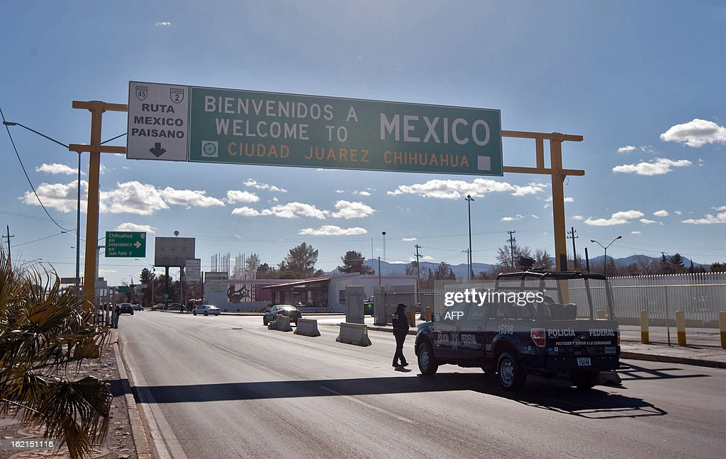 Police officers take part in a security operation on February 12 2013 in a street of Ciudad Juarez Chihuahua state Mexico According to official...