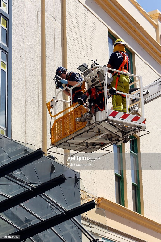 Police officers take photos of a bullet hole at the Broadway Shopping Centre along Bay Street, Broadway on March 4, 2013 in Sydney, Australia. Shots were reportedly fired at an Armaguard truck and police are investigating what a spokesperson said appears to be an attempted robbery.