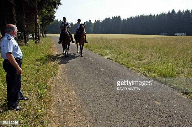 Police officers take place around the woods called ' Bois SainteCecile ' in Florenville 22 June 2005 where they conduct a search in the case of...