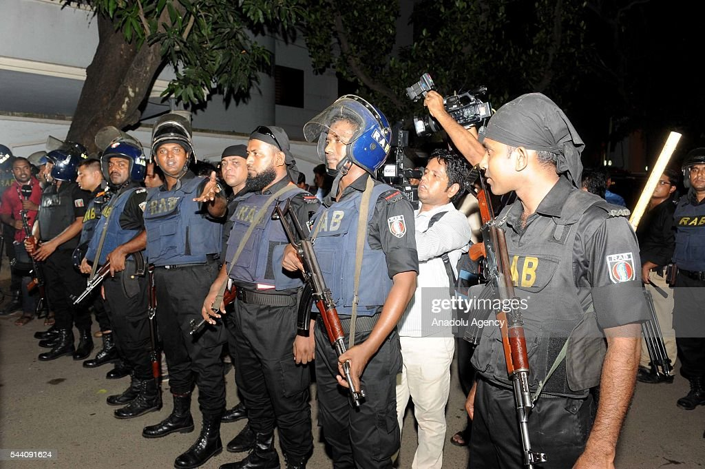 Police officers take security measures after armed attackers attack to a restaurant in Dhaka, Bangladesh on July 1, 2016.