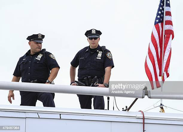 Police officers take security measures during a hotdog eating contest spicing up US Independence Day celebrations in New York NY on July 4 2015 The...