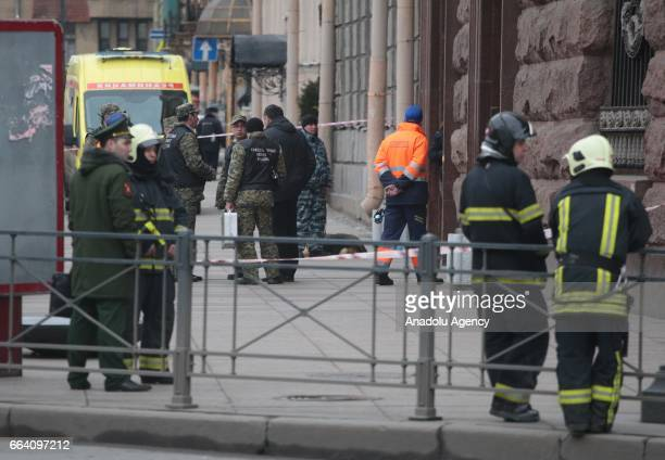 Police officers take security measures near the area after an explosion at a subway station in St Petersburg Russia on April 3 2017 At least 10...