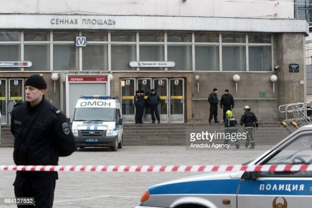 Police officers take security measures near the area after an explosion at a subway station in St Petersburg Russia on April 3 2017 A blast hit a...