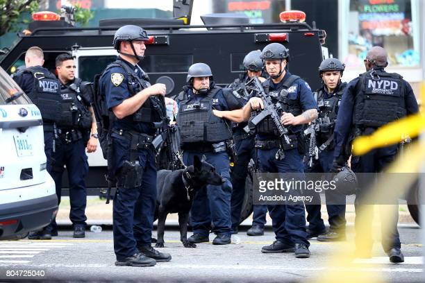 Police officers take security measures outside the BronxLebanon Hospital after a shooter opened fire killing at least one doctor before killing...