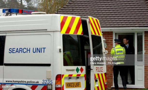 Police officers talk in the doorway of a house on Wellington Crescent in Baughurst Hampshire where explosive devices are believed to have been found...