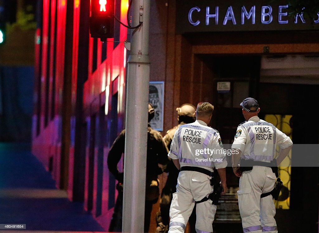 Police officers talk next to Lindt Cafe Martin Place on December 15 2014 in Sydney Australia Police attend a hostage situation at Lindt Cafe in...