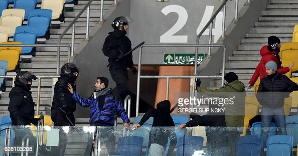 Police officers try to disperse Besiktas supporters during the UEFA Champions League football match between FC Dynamo Kyiv and Besiktas at the...