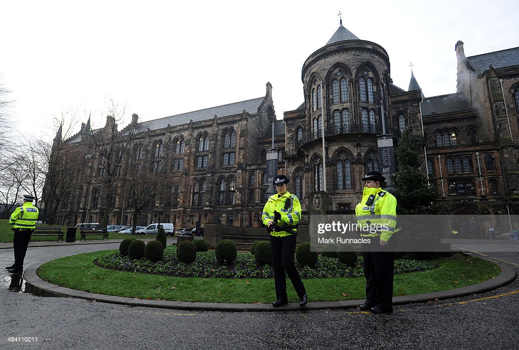 Police officers wait for the funeral cortege at the University of Glasgow's Bute Hall for Helicopter Pilot David Traill who died when the Helicopter...