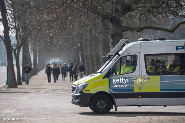 Police officers wait in a van on The Mall on March 24 2017 in London England A fourth person has died after Khalid Masood drove a car into...