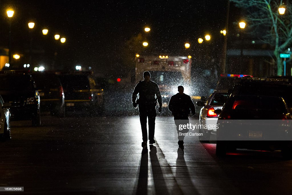 Police officers walk down North Main Street away from the scene of a standoff with shooting suspect Kurt Meyers on March 13, 2013 in Herkimer, New York. Police have identified 64-year-old Kurt Meyers as a possible suspect responsible for a total of four shooting deaths and two injuries across the area earlier in the day.