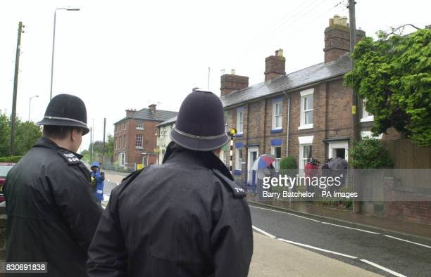 Police officers watch as members of the media talk to former Iain Duncan Smith campaign aide Edgar Griffin at his home in Welshpool Mr Griffin has...