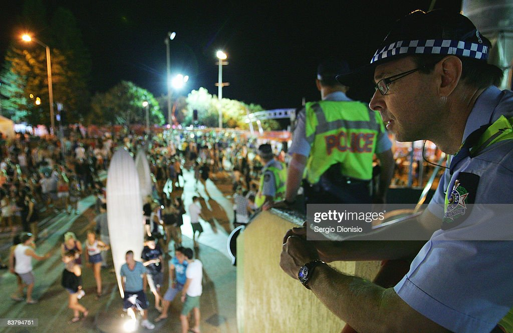 Police officers watch over the Schoolies week celebrations in Surfers Paradise on November 23 2008 on the Gold Coast Australia Schoolies is the...