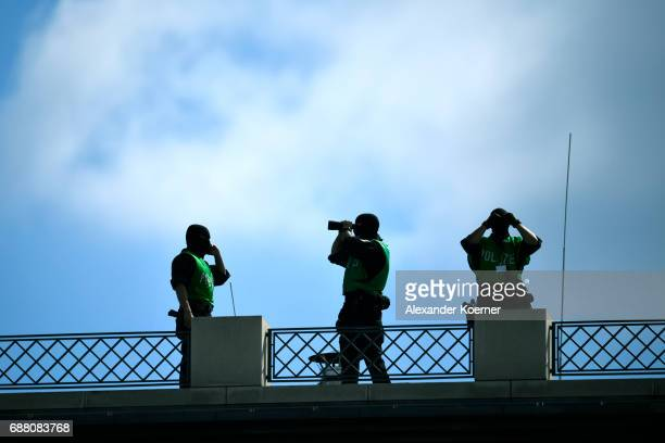 Police officers watch the crowd prior to the arrival of former President of the United States of America Barack Obama and German Chancellor Angela...