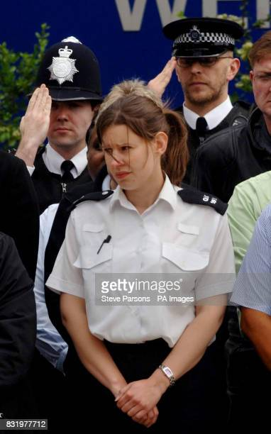 Police officers watch the funeral procession of murdered Special Constable Nisha PatelNasri as it makes it way makes it way past Wembley Police...