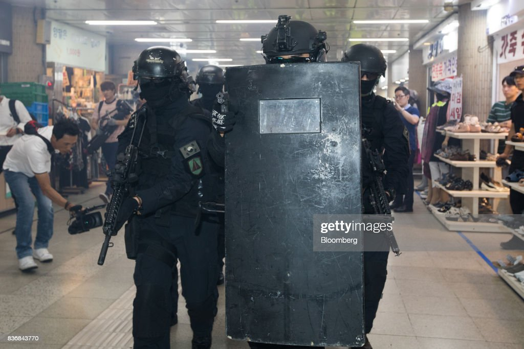 Police officers wearing gas masks take part in an anti-terror drill on the sidelines of the Ulchi Freedom Guardian (UFG) military exercises at a subway station in Seoul, South Korea, on Tuesday, Aug. 22, 2017. North Korea warned the U.S. on Tuesday it will face 'merciless revenge' for ignoring Pyongyangs warnings over annual military drills with South Korea. Photographer: SeongJoon Cho/Bloomberg via Getty Images
