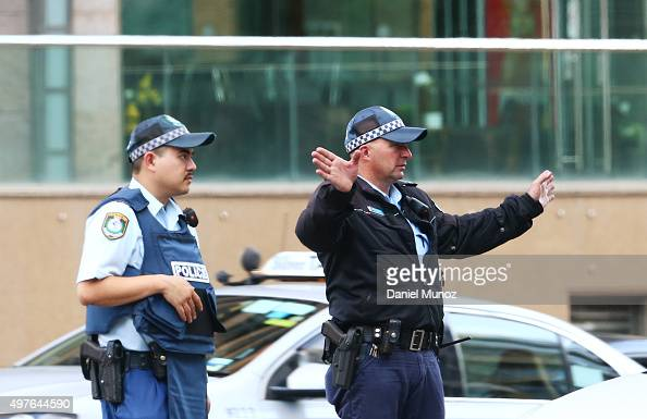 Police officers wearing life vests are seen close to 1 Oxford street building on November 18 2015 in Sydney Australia Armed police stormed the office...