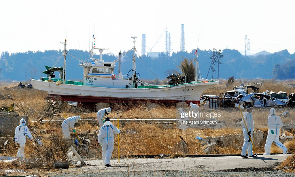 Police officers wearing the radiation protection gears search the missings at the evacuation zone, 7km from the crippled Fukushima Daiichi Nuclear Power Plant on February 19, 2012 in Namie, Fukushima, Japan.