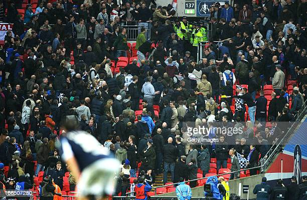 Police officers wield batons as they attempt to stop Millwall supporters fighting amongst themselves during the FA Cup with Budweiser Semi Final...
