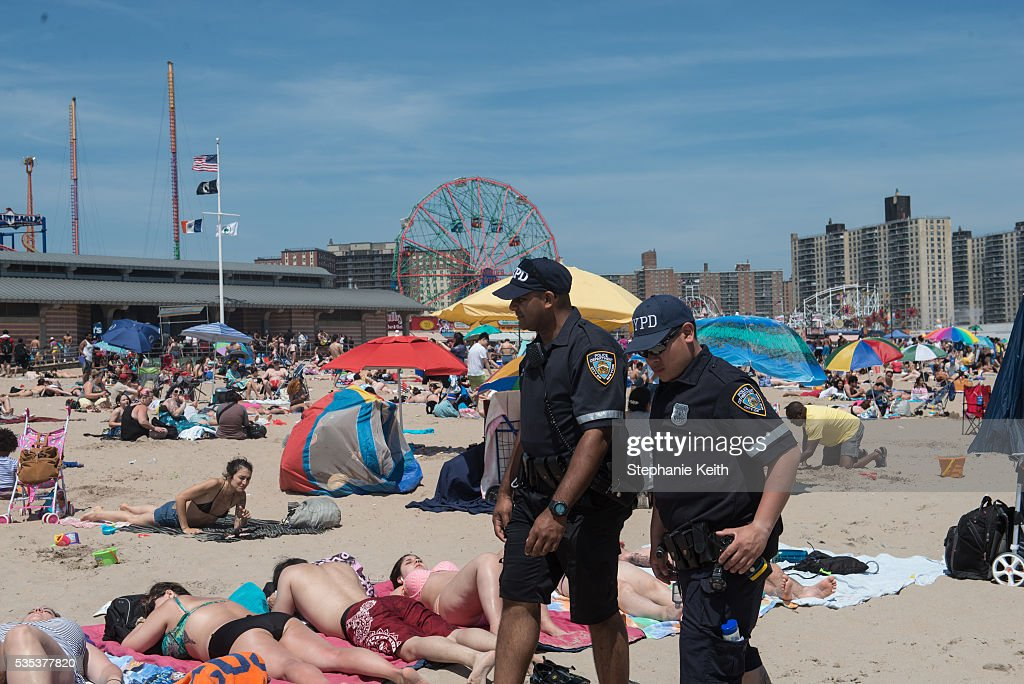 Police officers with the New York City Police Department patrol the beach in Coney Island on May 29, 2016 in the Brooklyn borough of New York City. New York City is experiencing higher than average temperatures for the holiday weekend.