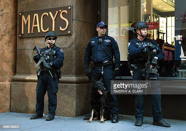 Police officers with the New York City Police Emergency Services Unit stand guard in front of Macy's at Herald Square on November 20 2015 in New York...