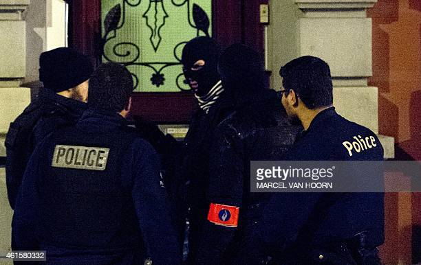 Police officers work in a cordoned off section of Colline street in Verviers eastern Belgium on January 15 after two suspected jihadists were killed...