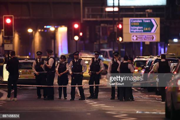Police officers work in a road leading to Finsbury Park Mosque after an incident in which a van hit worshippers outside the building on June 19 2017...