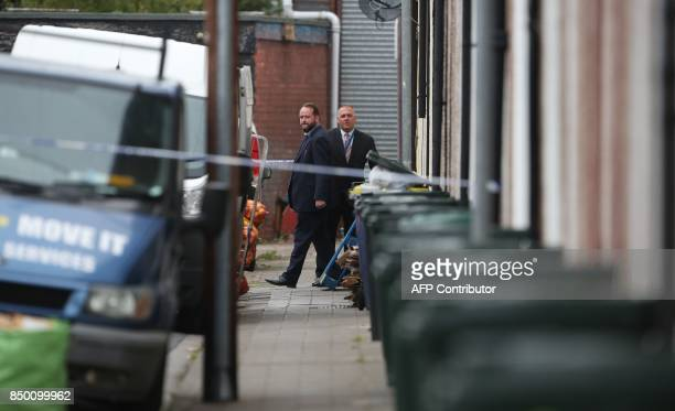 Police officers work inside a police cordon near to a house in Newport south Wales on September 20 as they continue their investigations into the...
