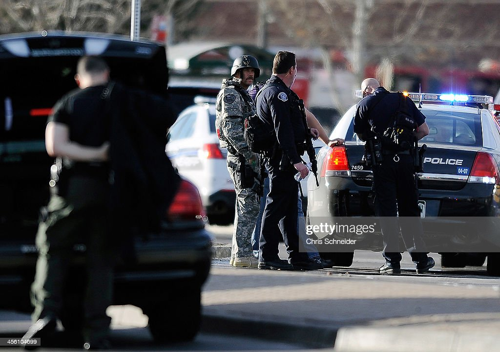 Police officers work outside Arapahoe High School after a school shooting on December 13, 2013 in Centennial, Colorado on Friday Dec. 13, 2013. According to authorities, two students were injured by a lone gunman who later died of a self-inflicted gun shot wound.