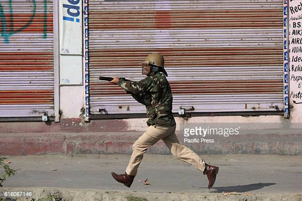 A police official taking position while chasing the stonepelters to fire tear gas canister to disperse them Tensions engulfed Valley on July 8 when a...