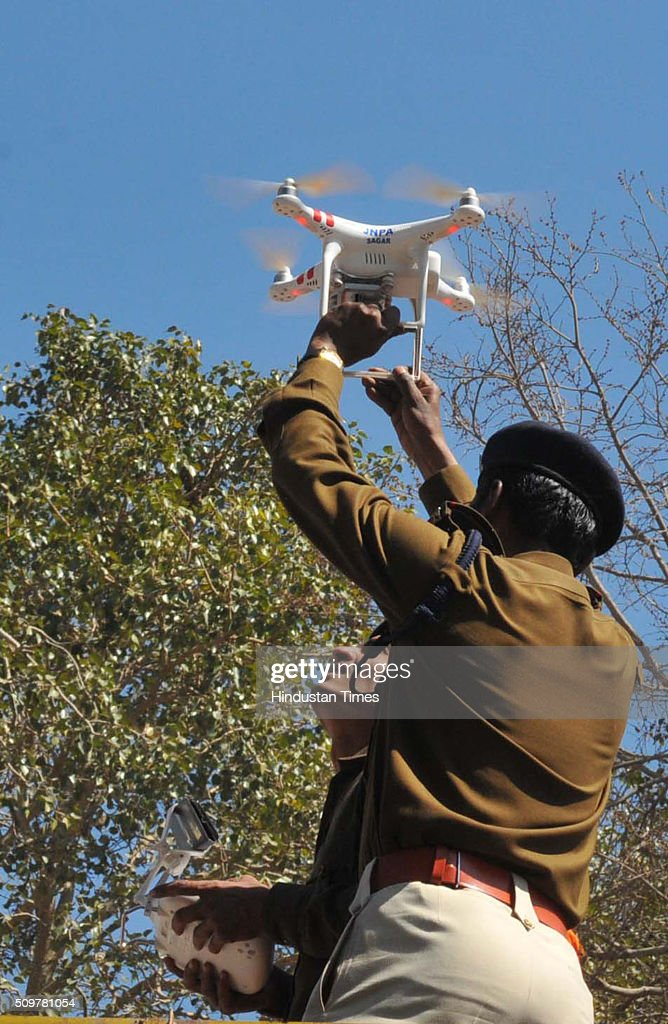 A police officail trying to fly a drone camera at Bhojshala on February 12, 2016 in Dhar, India.The contested site is the Kamal-al-Din congregational mosque of Dhar also known as Bhojshala is protected by the Archaeological Survey of India, which allows Muslims to offer jummah or Friday prayers. Hindus are allowed entry in the monument to offer prayers on Tuesdays and conduct a special puja on the occasion of Basant Panchami. This week, however, the Friday prayers coincide with the festival of Basant Panchami.
