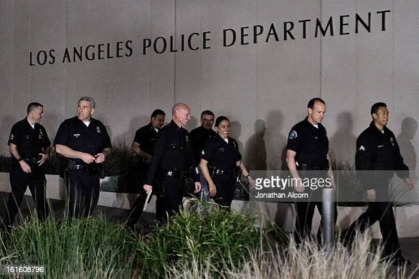 Police officials arrive for a media briefing outside the Police Administration Headquarters regarding former LAPD officer Christopher Dorner February...