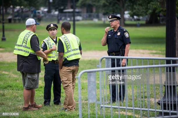 Police officials coordinate where to put barricades on the Boston Common where a 'Free Speech' rally is scheduled and a large rally against hate in...