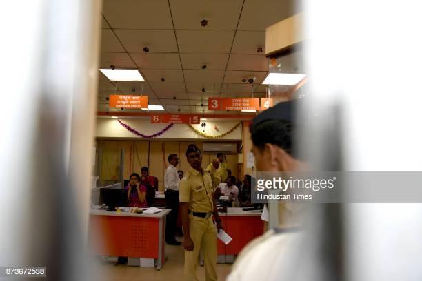 Police officials doing investigation at Bank of Baroda Juinagar Branch after bank robbery was discovered on November 13 2017 in Navi Mumbai India...