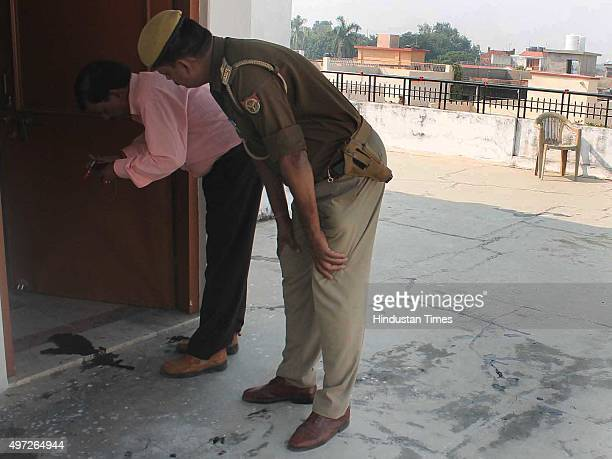 Police officials examine the house where the Russian acidattack victim was living on November 14 2015 in Varanasi India The 23yearold Russian...