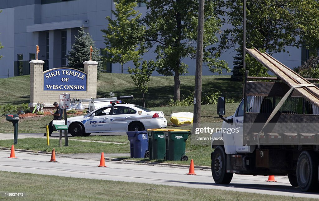 Police officials stand guard outside the Sikh Temple of Wisconsin August, 7, 2012 Oak Creek Wisconsin. A suspected gunman, 40-year-old Wade Michael Page, allegedly killed six people at the temple August 5, was shot to death by police at the scene. He was an army veteran and reportedly a former leader of a white supremacist heavy metal band. Three others were critically wounded in the attack.