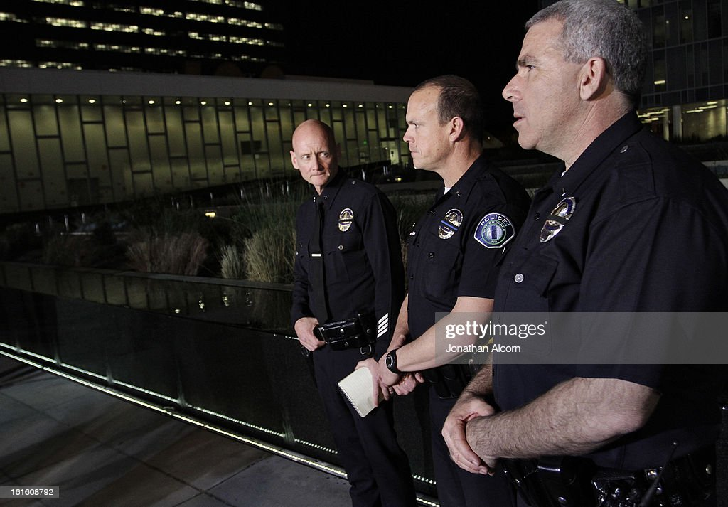 Police officials stand together during a media breifing outside the Police Administration Headquarters regarding former LAPD officer Christopher Dorner, February 12, 2013 in Los Angeles, California. Dorner barricaded himself in a cabin near Big Bear, California which later caught fire. According to the LAPD the cabin remains too hot to enter and a body has not been located.