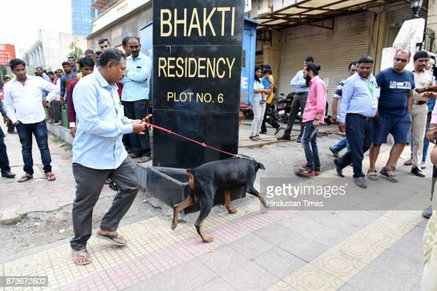Police officials use dog sqaud during investigation at Bank of Baroda Juinagar Branch after bank robbery was discovered on November 13 2017 in Navi...