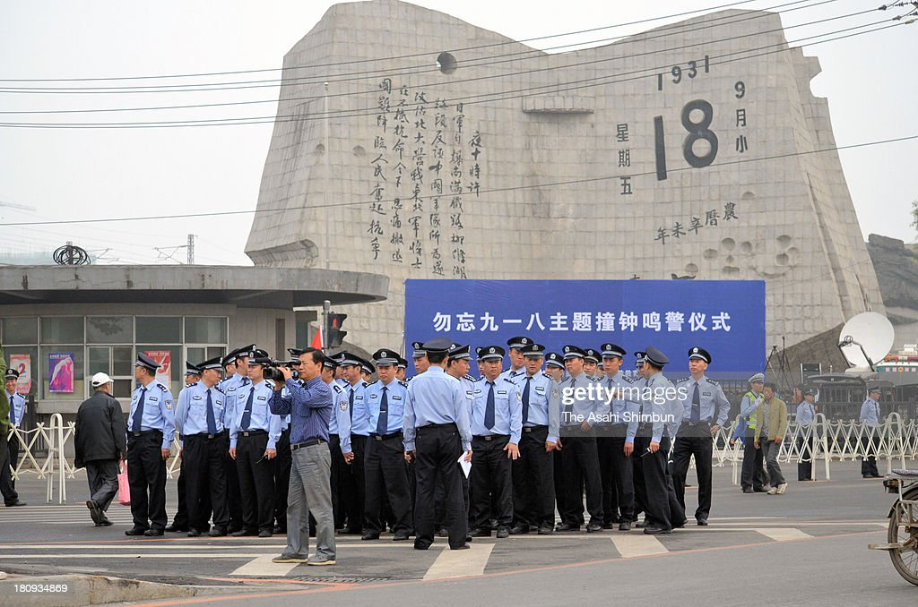 Police offiers stand guard in front of the September 18th History Museum on September 18, 2013 in Shenyang, China. China marks 82nd anniversary of the 1931 Mukden Incident, when Imperial Japan army bombed a railway in Liutiaohu, Manchuria.